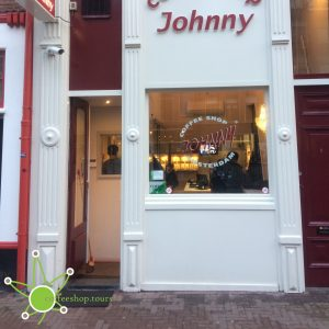 The small little storefront of Johnny's Coffeeshop on Elandsgracht.